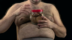 Hairy overweight man eating cookies. Stock Footage
