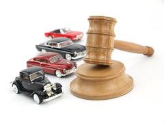 Gavel auction and cars - stock photo