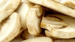Slow slide from white to delicious isolated macro of sliced mushrooms in 4K. Stock Footage