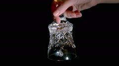 Crystal hand bell on a black background Stock Footage