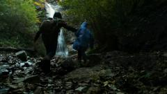 Mother with son hiked a long way to Waterfall Stock Footage