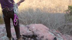 Rock Climber Prepares RopesFor Climb Stock Footage
