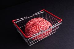 Brain and shoppingcart isolated on Black - stock photo