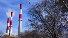 Smokestacks from the Ravenswood Generating station in Queens rise above a city Stock Footage