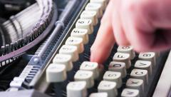 old typewriter typing. Vintage typewriter being used by male hands seen from - stock footage