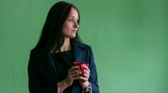 A woman in a business suit with a red cup Stock Footage