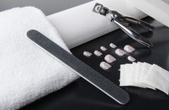 Composition with an equipment of false-nails application - stock photo
