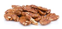 Heap of pecan nuts - stock photo