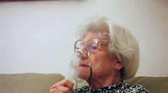 Stock Video Footage of Old woman with respiratory problem, inhalation, sick asthmatic patient, inhaler