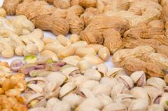 Assortiment of peanuts, cashews and pistachios - stock photo