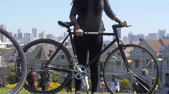 Bicyclists at Alamo Square Park, San Francisco Stock Footage