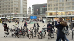 Berlin district Mitte at Alexanderplatz with people and train traffic Stock Footage