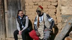 Girl talk with masked boy. village of Turia - Bulgaria, Europe - stock footage