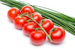 Cluster tomatoes with chive - stock photo