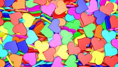 4K Colorful hearts is falling down on a white and forming a wall Stock Footage