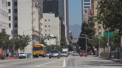 School bus traffic street Los Angeles downtown boulevard commuter travel day USA Stock Footage