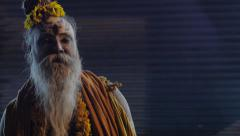 Indian Sadhu Priest stands on Busy Street Corner Stock Footage