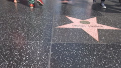 POV Point of view pedestrian people feet walk fame Hollywood award avenue iconic Stock Footage