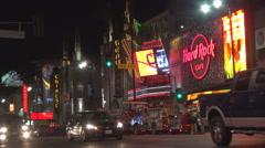 Busy traffic car Hollywood boulevard night shop neon sign Los Angeles iconic USA Stock Footage