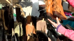 Spain Mallorca Island Sineu village 015 look at new boots on weekly market Stock Footage