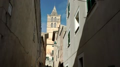 Spain Mallorca Island Sineu village 007 church tower at the end of old alley Stock Footage