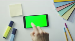 Designer is Using Android Phone with Green Screen in Landscape Mode. Top View. - stock footage
