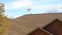 UAV-16, drone helicopter MWS, descends in front of house Stock Footage