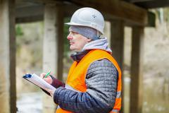 Engineer with  documentation under the bridge Stock Photos