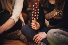 Women playing Hand Sleigh Bells Kuvituskuvat