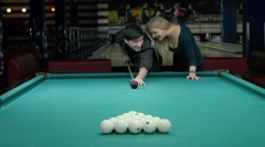 Happy couple playing pool. she supports her partner Stock Footage