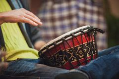 Person playing on Jambe Drum no face Kuvituskuvat