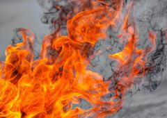 Stock Illustration of The flames of the fire in the day time.