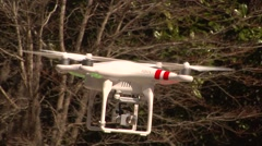 UAV-14, drone helicopter CU flys, rotates,  low level with tree grass background Stock Footage