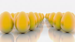Abstract golden eggs on white background - stock footage