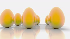 Abstract golden eggs on white Stock Footage