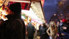 People enjoying the famous Christmas Market in Paris, France Stock Footage