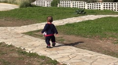 Stock Video Footage of Funny gait of a newly walking baby