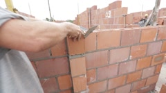 Mason arranges brick in the wall Stock Footage
