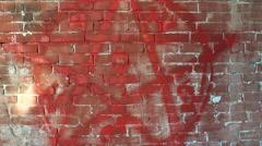 Pentagram, symbol of Satan on a brick wall. Stock Footage