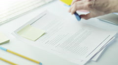 Designer is Marking Text in Document with Highlighter. Stock Footage
