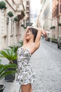 Beautiful sexy asian woman relaxed posing in urban scene Stock Photos