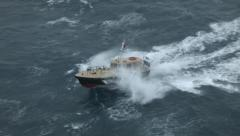 Bad weather - motorboat fights the waves Stock Footage