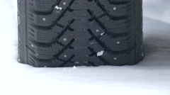 Studded tyre in snow Stock Footage