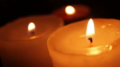 Candles blazing in the dark Stock Footage
