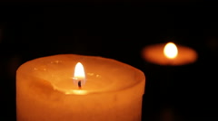 Two candles blazing in the dark Stock Footage