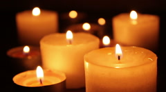 Many candles burning in a dark - stock footage