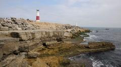 Portland Bill Lighthouse Dorset England UK boat sailing by coast Stock Footage