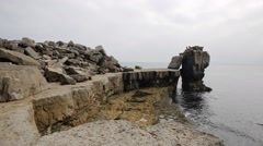 Rock stack by Portland Bill Lighthouse Isle of Portland Dorset England UK Stock Footage