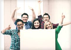 Students at school with blank white board Stock Photos
