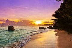 Sunset on beach Source D'Argent at Seychelles Stock Photos